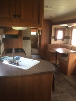 Kitchen and dining area of Camper 1 High Tide Trailer Rentals
